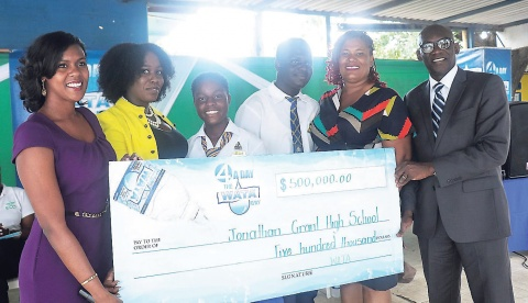 The WATA team presents a $500,000 cheque